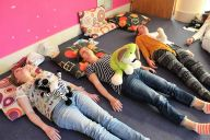 Teachers taking part inbuddy breathing activities on a Smart Teachers Play More creative educational course.