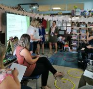 Teachers learning how to use the housing game to teach kindergarten children ona smart teachers play more coure