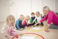 Teacher using the Smart Teachers Play More housing game to teach children curriculum based subjects