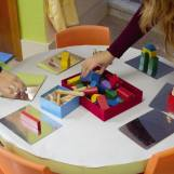 people playing with building blocks on a table