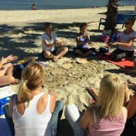 Teachers sitting in a circle on the beach in Alicante on a Smart Teachers Play More creative educational course