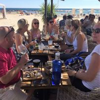 Teachers enjoying dinner on the beach in Alicante on a Smart Teachers Play More course