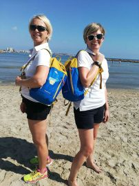 Sarah and Krisitn model Smart Teachers Play More backpacks on the beach in Alicante